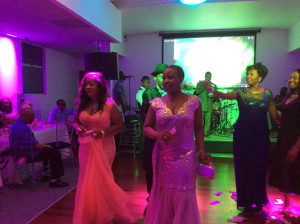 A cross section of guests dancing with Dr. and Mrs. Omoigui at the event.