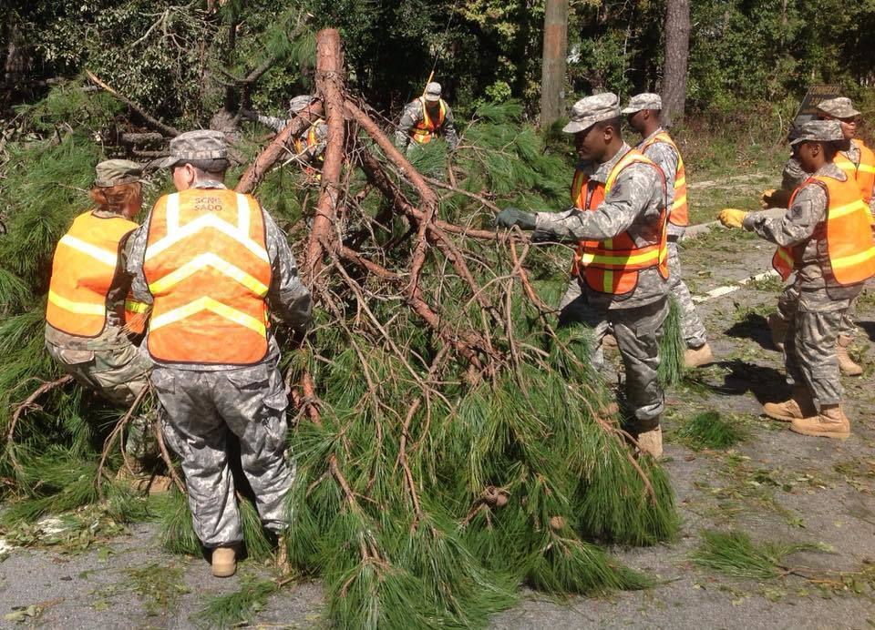 South Carolina National Guard soldiers with the 1263rd Forward Support Company remove tree debris from highway SC 46 in Bluffton, S.C., Oct. 9, 2016, in the aftermath of Hurricane Matthew. About 2,800 South Carolina National Guard soldiers and airmen were activated to support state and county emergency management agencies and local first responders after Gov. Nikki Haley declared a state of emergency. National Guard photo by Army Sgt. 1st Class Joe Cashion