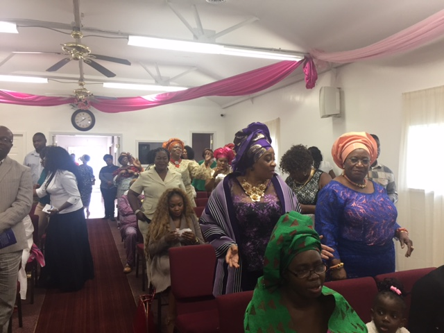a-cross-section-of-guests-singing-during-the-church-dedication