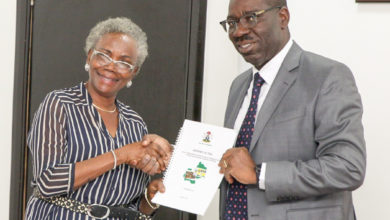 The Edo State Governor, Mr. Godwin Obaseki, receiving the Report of the Joint Implementation Team on Public Libraries from the Chairperson of the Committee, Mrs. Grace Sanni, at the Edo State Government House on Tuesday, August 1, 2017